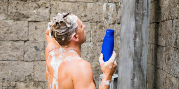 man showering purchased from Canva